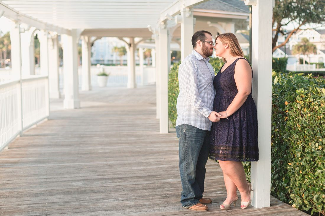 Couple at Sea Breeze point at Disney Boardwalk for their enagement photography session