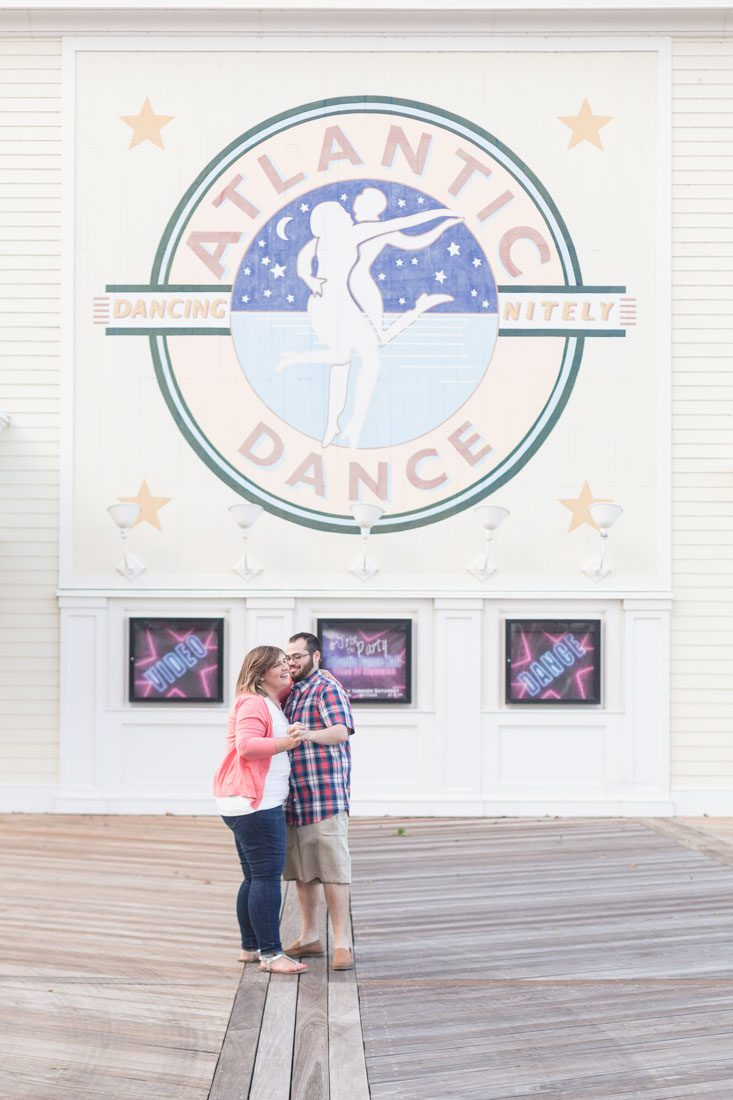 Couple dancing at Disney Boardwalk for their engagement portrait session