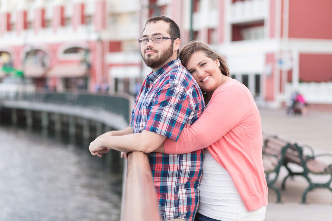 Orlando engagement photographer captures couple overlooking the water at Disney Boardwalk during their photo shoot
