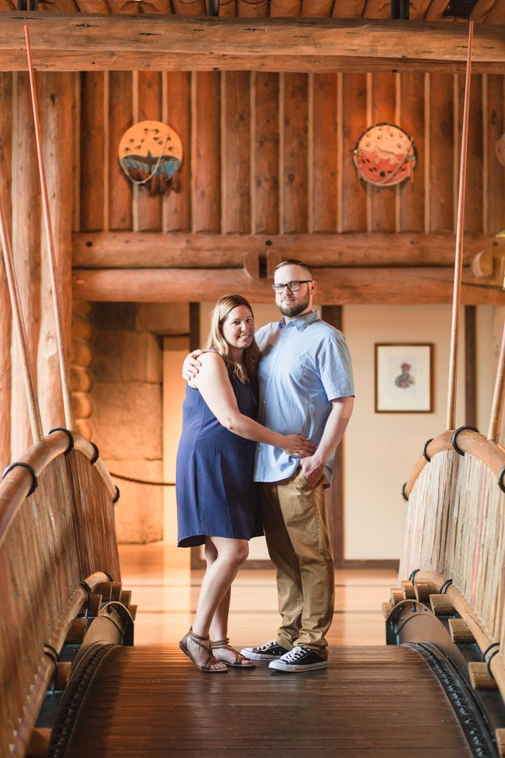 Couples pose at the bridge in the Wilderness Lodge for their engagement photos with Orlando photographer