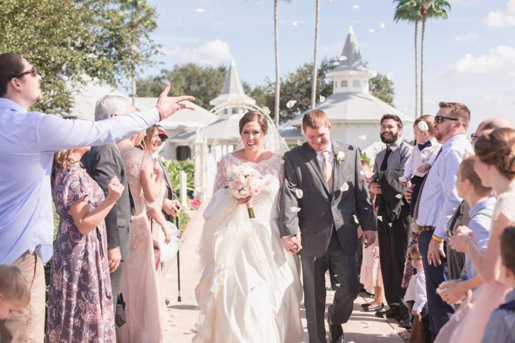 Flower petal exit from Disney's wedding pavilion by Orlando photographer