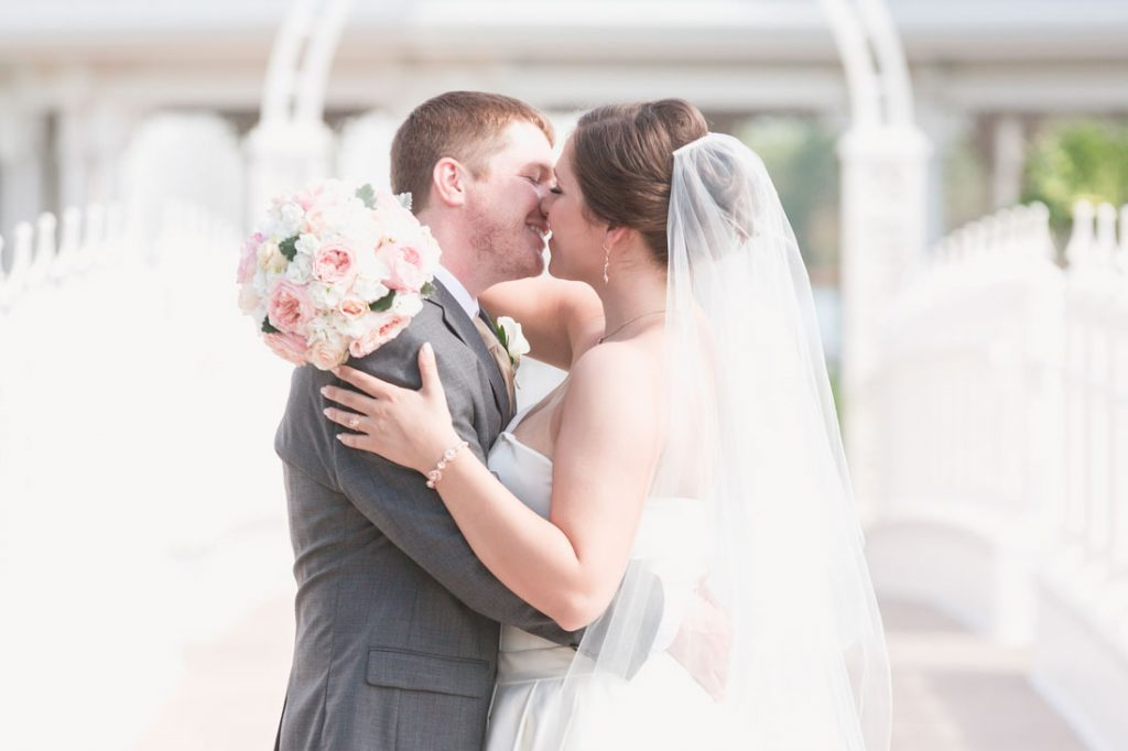 Orlando wedding photographer captures couple in front of the Disney wedding pavilion for portraits