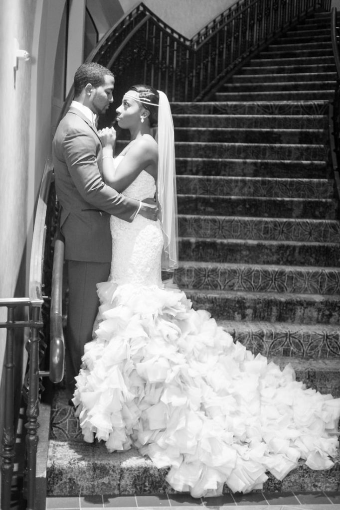 Bride and groom pose on the stairs at the Gaylord Palms