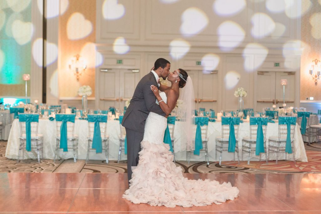 Bride and groom in their Tiffany blue reception room at the Gaylord Palms in Orlando, Florida