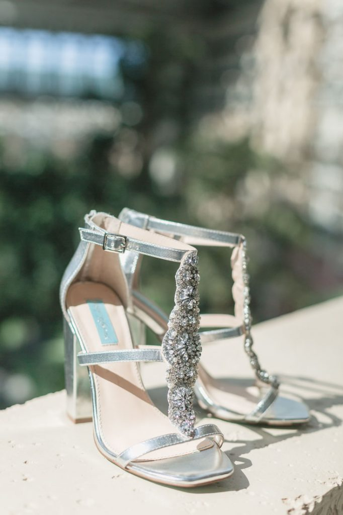 Close up of the brides Betsey Johnson wedding shoes by Orlando photographer