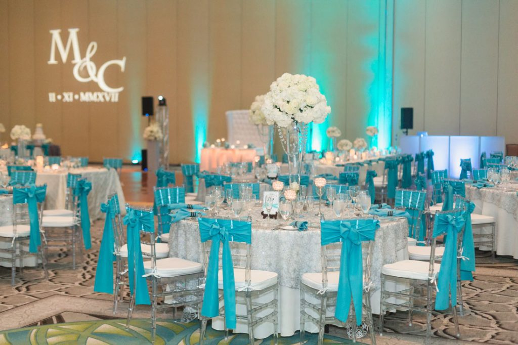 Glitz and glam sparkly Tiffany blue wedding reception at the Gaylord Palms by Orlando photographer