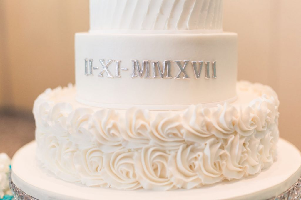 White wedding cake with monogram by Party Flavors in Orlando, Florida