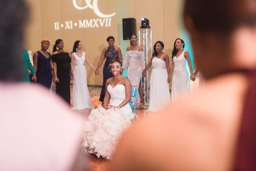 Bride is serenaded by her sorority sister at Gaylord Palms wedding in Orlando
