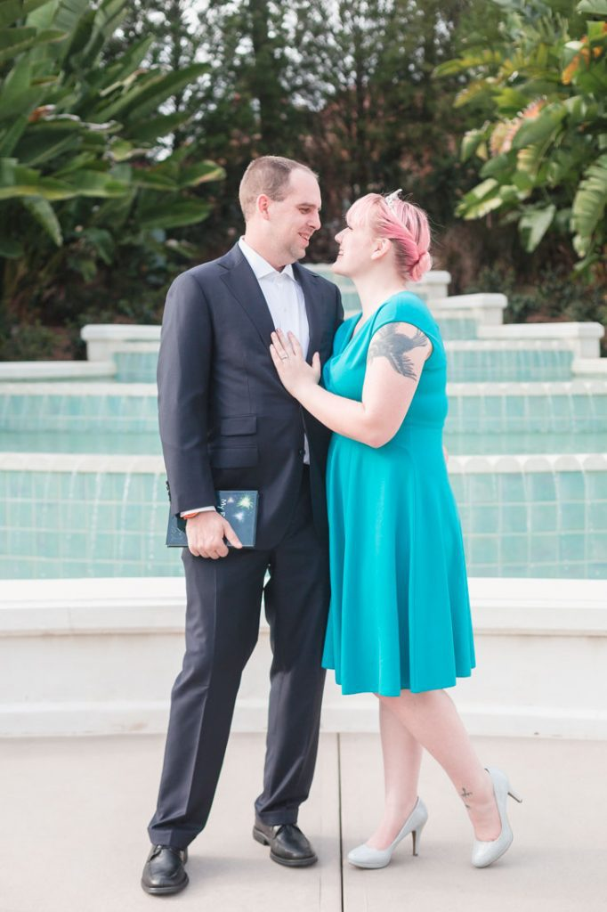 Newly engaged couple poses for engagement photo following a surprise proposal at Disney's Grand Floridian in Orlando