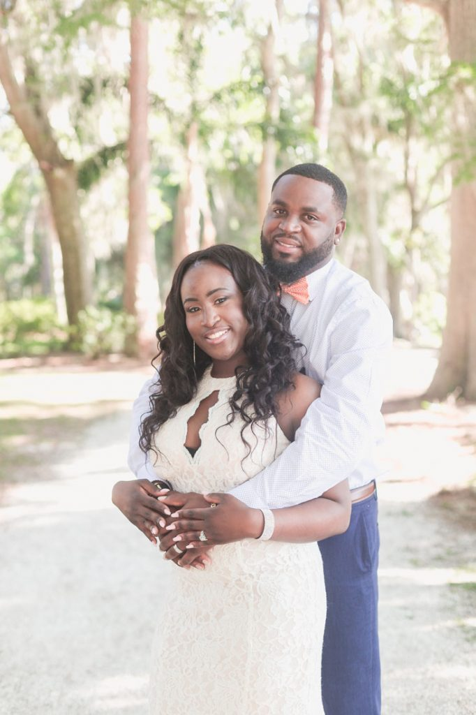 Sweet and intimate wedding ceremony at the monument at Kraft Azalea gardens in Winter Park captured by Orlando photographer