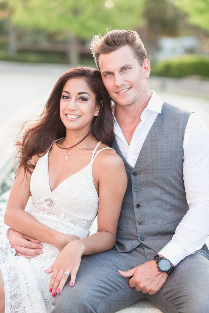 Sweet and romantic engagement portrait session in front of a fountain at Winter Garden City Hall by Orlando wedding photographer Captured by Elle