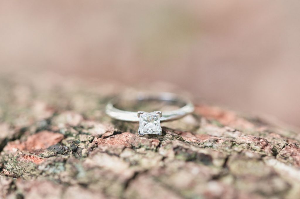 Engagement ring close up on a tree at Kraft Azalea gardens during this romantic Winter Park engagement shoot