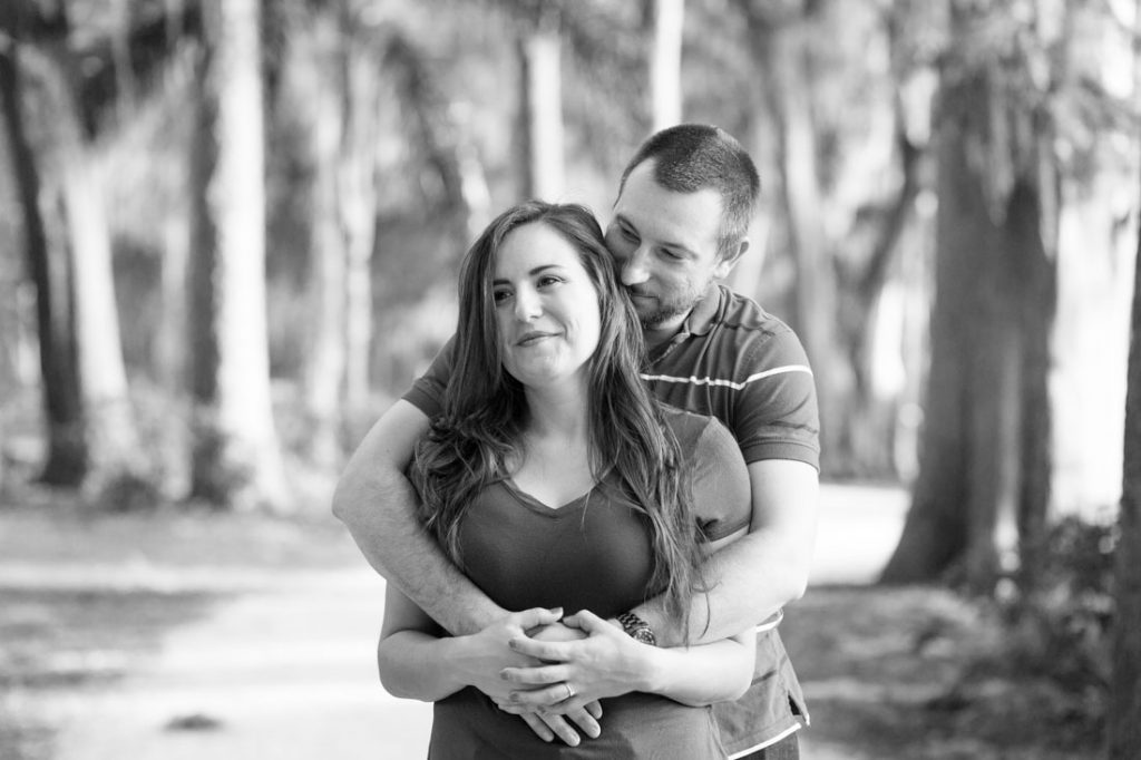 Romantic black and white engagement photo taken by top Orlando wedding photographer at Kraft Azalea gardens by the water