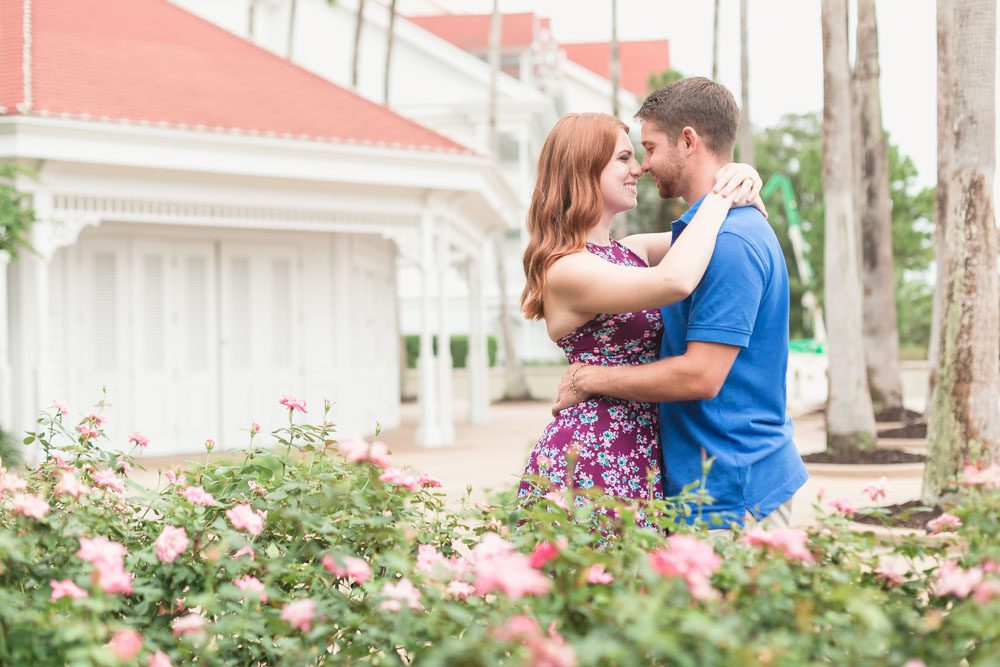 Romantic engagement session photo with roses at Disney's Grand Floridian Resort captured by Central Florida photographer