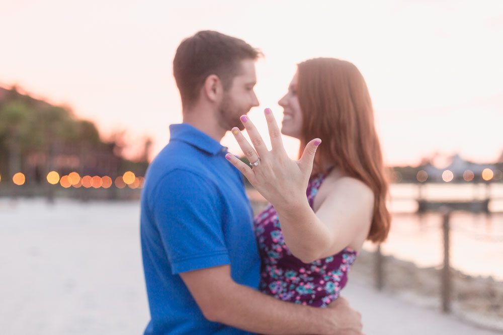 Bride to be showing off her engagement ring during a sunset photo shoot at Disney Polynesian resort captured by top Orlando photographer