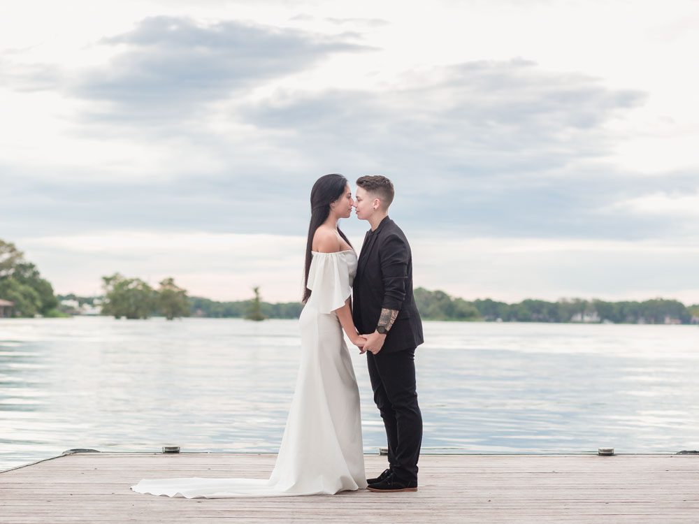 Orlando wedding photographer captures beautiful LGBT elopement at Kraft Azalea gardens on the lake and pier