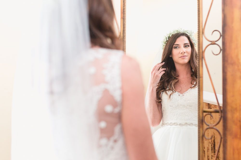 Bride getting ready at Paradise Cove captured by top Orlando wedding photographer and videographer