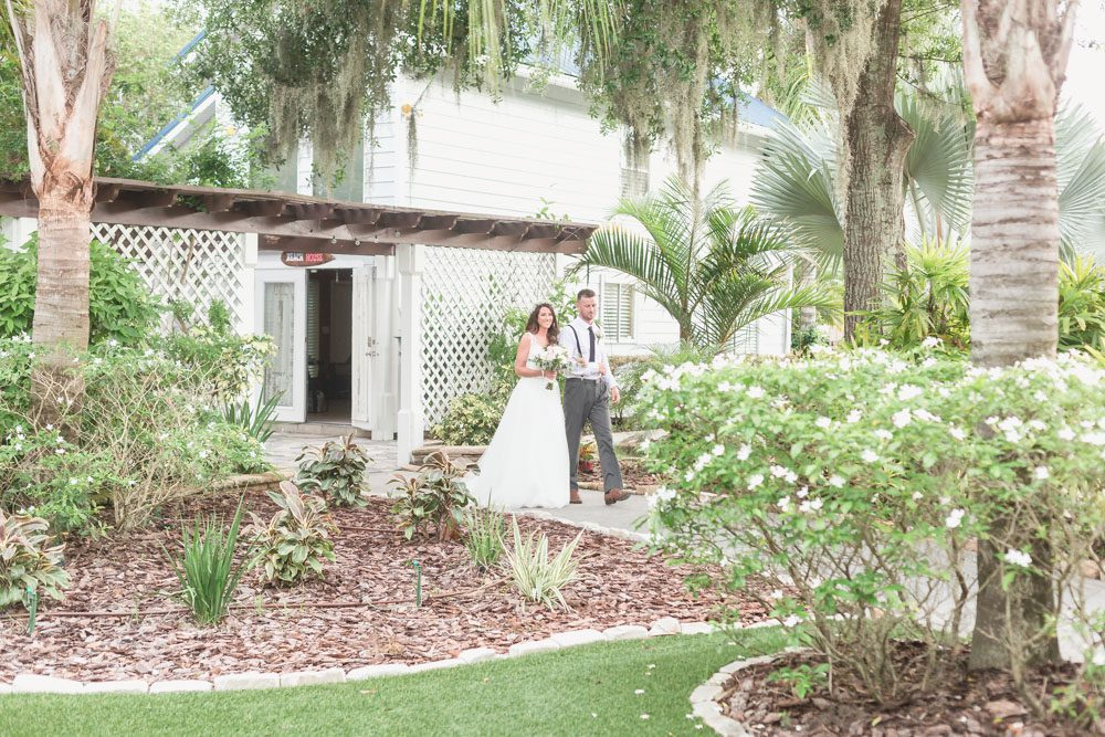 Bride walking down the aisle at Paradise Cove captured by top Orlando wedding photography and videography team