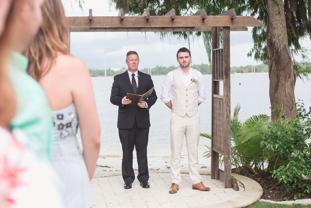 Groom sees the bride for the first time down the aisle at Paradise Cove in Orlando Florida