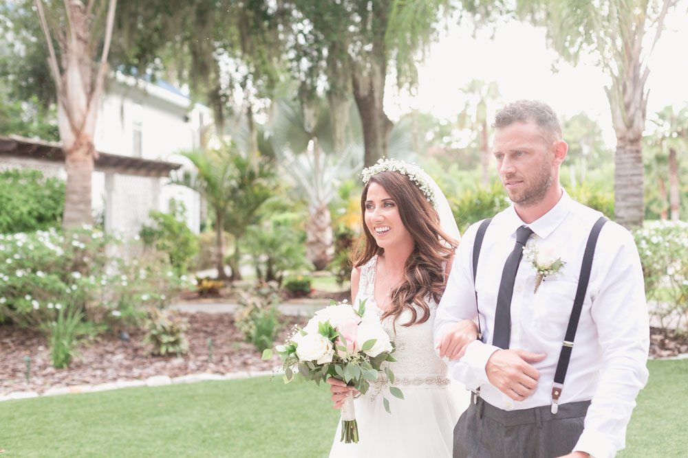 Orlando wedding photographer captures the Bride beaming as she sees her groom down the aisle