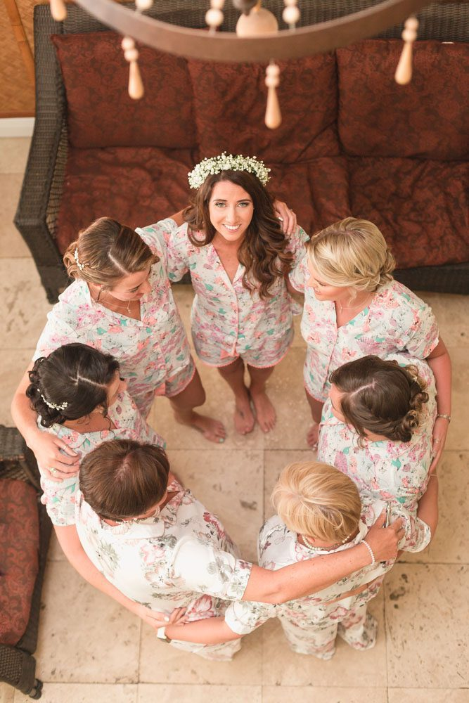 Bride in the getting ready suite at Paradise Cove with her bridesmaids in adorable Disney themed pajamas