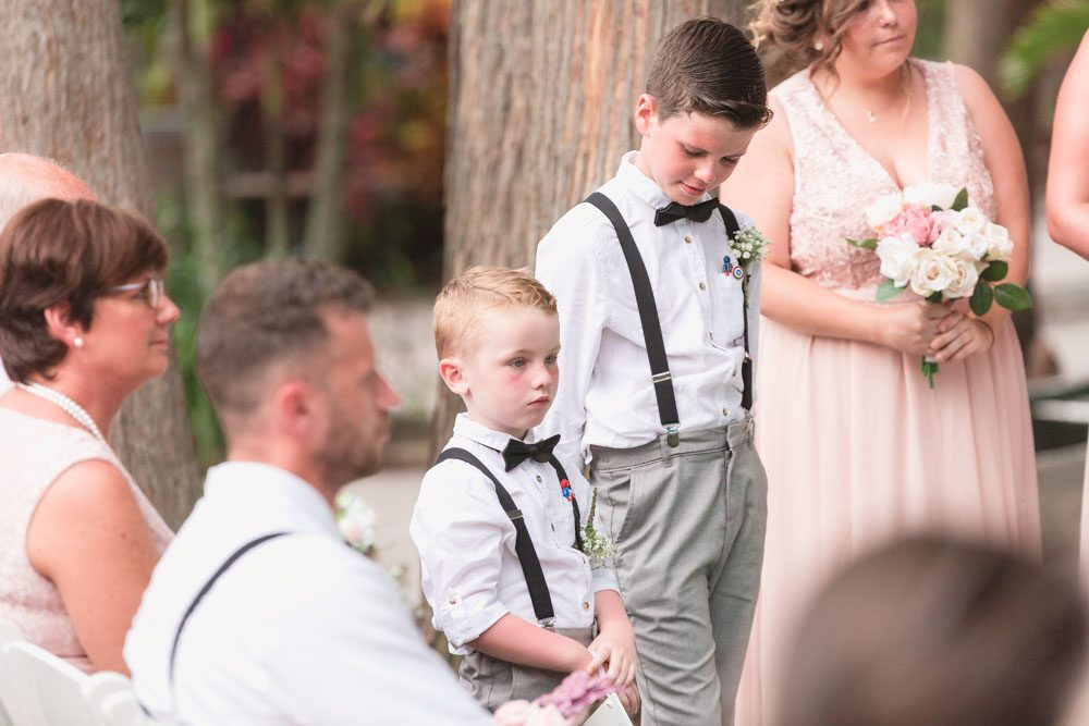 Ring bearers look on during this romantic beachy ceremony at Paradise Cove in Central Florida