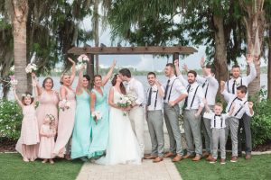 Bridal party cheering on bride and groom at Paradise Cove at top wedding venue in Orlando, Florida