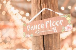 Adorable 'Dance Floor' sign pointing guests to the party at this paradise cove wedding reception in Orlando