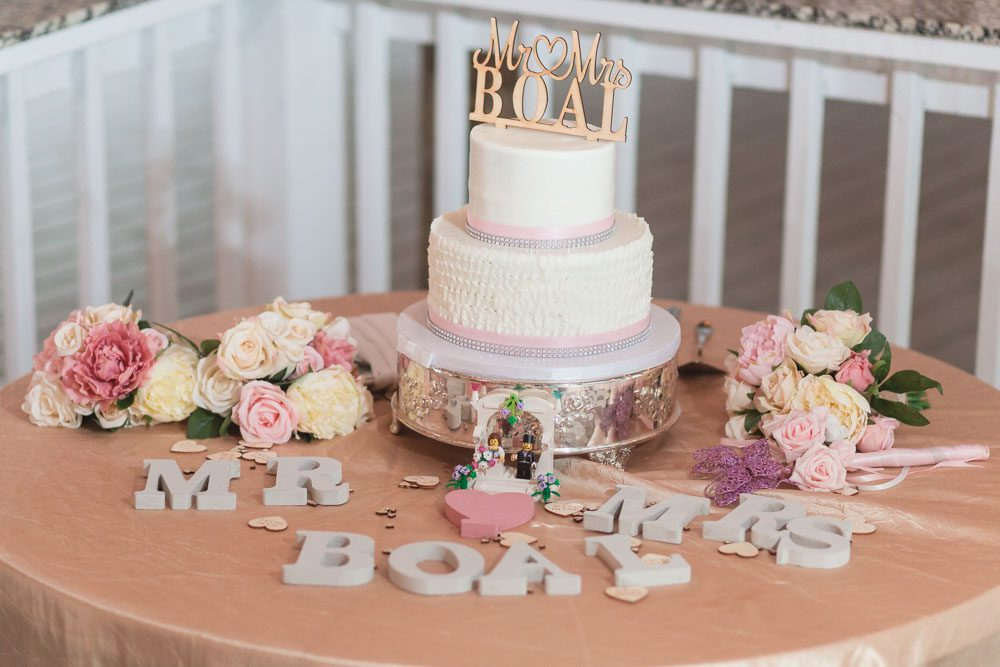 Wedding cake table at Paradise Cove Orlando captured by wedding photographer and videographer