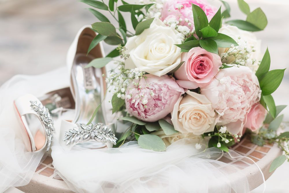 Close up of the bridal bouquet and shoes captured by top Orlando wedding photographer and videographer
