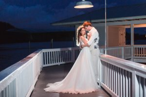 Gorgeous nighttime portraits of the bride and groom at Paradise Cove captured by top Orlando wedding photographer