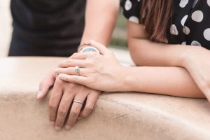 Close up of the couple's wedding rings during their anniversary portrait session at Disney World in Orlando, Florida
