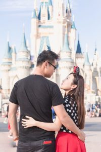 Anniversary photo shoot in front of the Cinderella castle in Orlando during the couples vacation to Central Florida