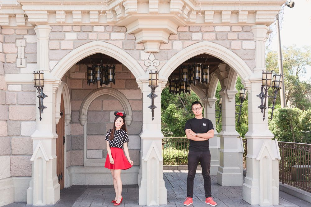 Fun and playful photography session at Walt Disney World castle in the theme park captured by top Orlando wedding and engagement photographer