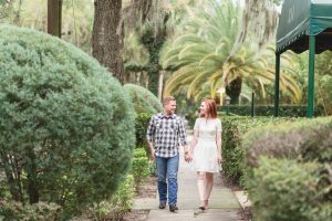 Engaged couple walking along the sidewalk during their beautiful photo shoot in Winter Park with one of the best wedding photographers in Orlando