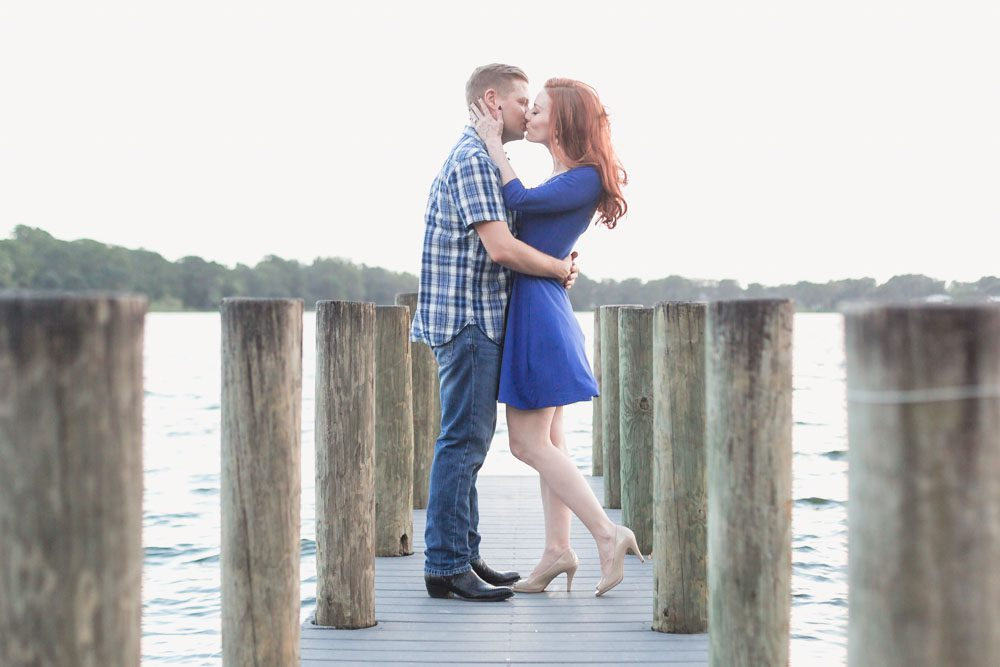 Romantic engagement photography on a pier in Winter Park at sunset captured by top Orlando wedding photographer