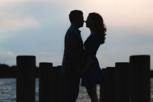 Silhouette of an engaged couple on the dock at Winter Park Rollins College during their engagement photo shoot