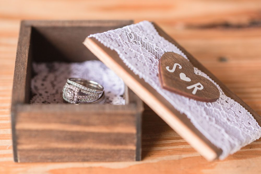 Close up of the wedding rings for a country wedding captured by top Orlando wedding photographer