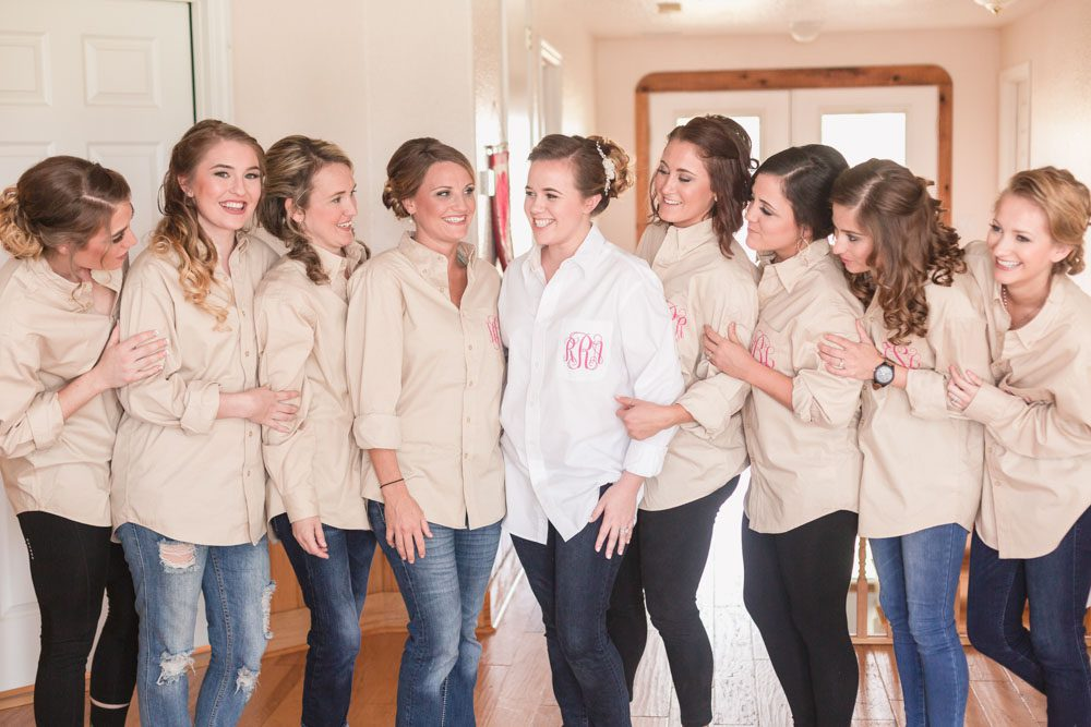 Bridesmaids with custom monogrammed shirts during a country wedding day captured by Orlando wedding photography team