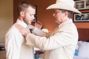 Groom and his dad getting ready for their country wedding day at a barn north of Orlando Florida