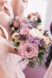 Orlando wedding photographer captures beautiful Blush pink and purple bouquets for a rustic country wedding