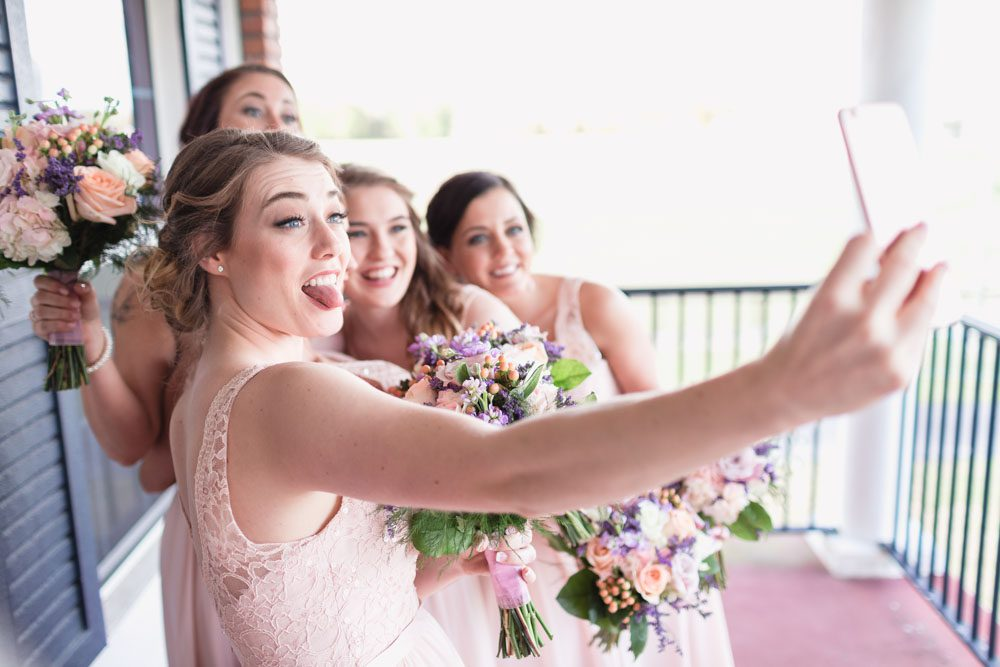 Bridesmaids taking a fun selfie during a country rustic wedding north of Orlando