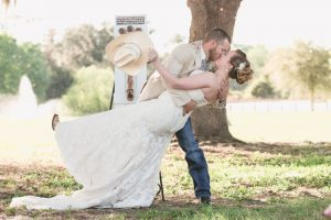 A knock out first kiss at a country wedding ceremony outdoors at a farm north of Orlando Florida