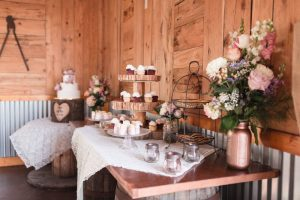 Dessert table with a lace runner at a country rustic wedding captured by top Orlando wedding photography team