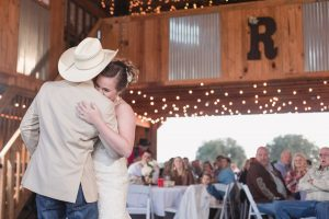 Bride shares a first dance with her groom at their barn wedding reception north of Orlando
