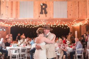 Chic country inspired wedding day at a red barn north of Orlando captured by top wedding photographer