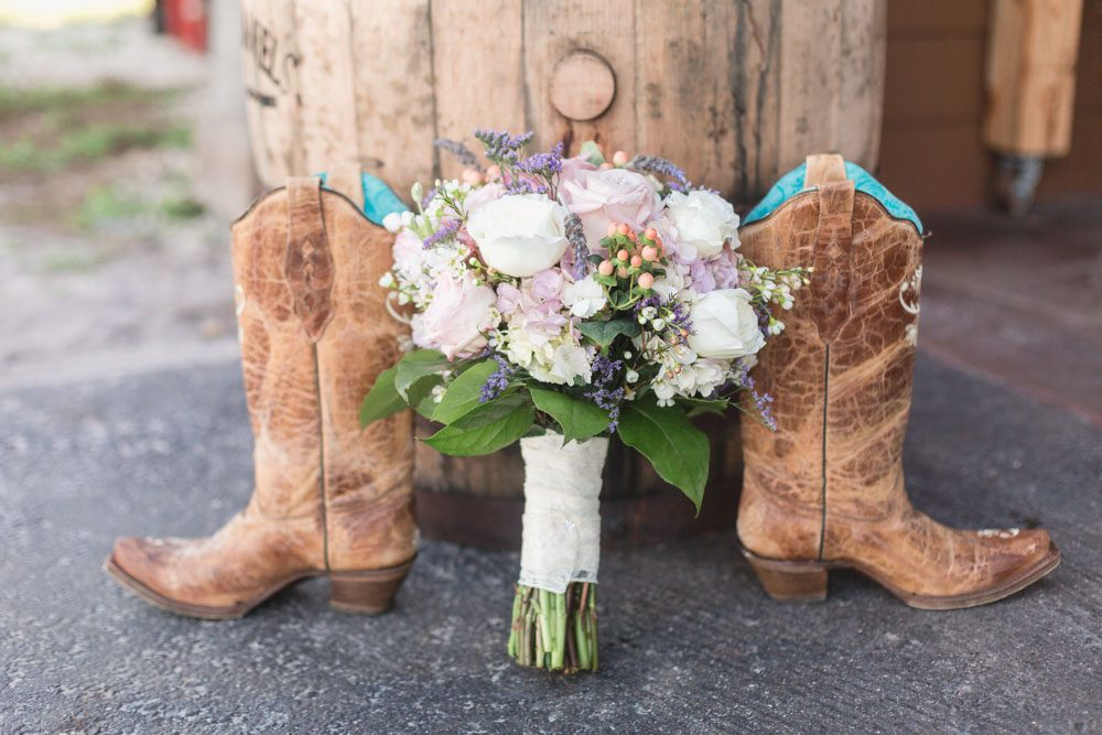 Rustic country wedding cowgirl boots and bouquet featuring burlap and lace for a barn wedding in Orlando, Florida