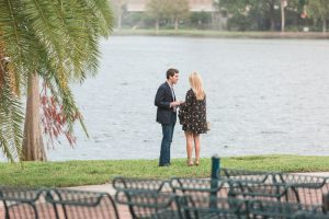 Surprise marriage proposal along the water at Lake Eola in downtown Orlando by the amphitheater