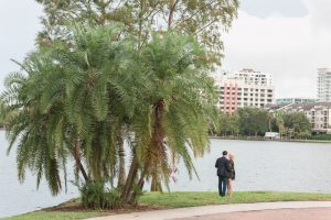 The future bride is caught off guard by this surprise proposal in downtown Orlando, Florida on the lake captured by top engagement and proposal photographer in Central Florida