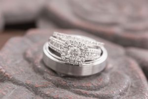 Close up of the wedding rings on a wrought iron table captured by top Orlando wedding photographer and videographer